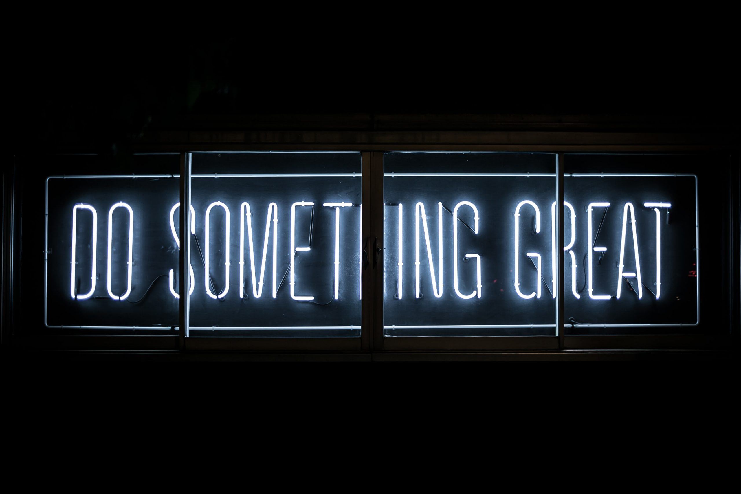neon sign do something great to monetise online and hybrid events